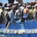 Un barcone di migranti approda nel porto di Lampedusa, oggi 9 aprile 2011. ANSA / ETTORE FERRARI