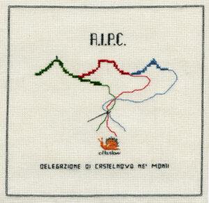 (Logo di A.I.P.C., delegazione di Castelnovo ne' Monti)