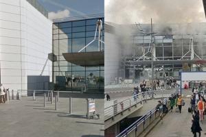 Fumo e vetrate distrutte. Così appare l'aeroporto internazionale di Bruxelles Zaventem subito dopo l'attacco suicida avvenuto alle 8 di mattina. Le deflagrazioni, almeno due, nella hall del terminale partenze, a poca distanza dal banco della American Airlines. Nelle immagini che seguono, la struttura prima e dopo l'attentato (Foto La Repubblica)